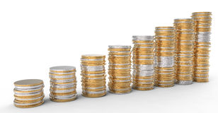 Financial Progress: golden and silver coins stacks. Over white Stock Photography