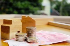 Property investment concept in China. High inflation in recent years. Financial property investment in and house mortgage in China concept. stacks of coins royalty free stock image
