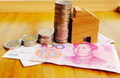 Property investment concept in China. High inflation in recent years. Financial property investment in and house mortgage in China concept. stacks of coins royalty free stock photo