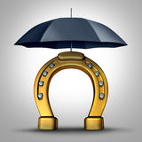Financial Prosperity Security. And protecting fortune wealth metaphor and luck concept as a horse shoe or horseshoe icon protected by an umbrella as a 3D Royalty Free Stock Images