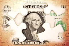 Financial puzzle. U.S. one dollar and puzzle pieces Stock Images