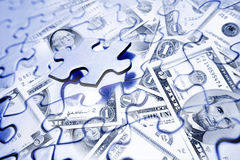 Financial puzzle. Jigsaw puzzle and American banknotes Royalty Free Stock Image