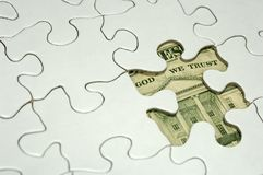 Financial Puzzle. Photo of a Puzzle With a Missing Piece and Money Underneath - Financial Puzzle Concept Stock Image