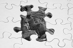 Financial Puzzle. Puzzle With Quarter Below Royalty Free Stock Photos
