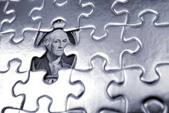 Financial puzzle. One dollar U.S. banknote behind puzzle Royalty Free Stock Photography