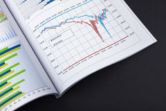 Financial report. A book with financial report and graphs Royalty Free Stock Photo