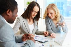 Financial report. Business team meeting to analyze financial report royalty free stock photo