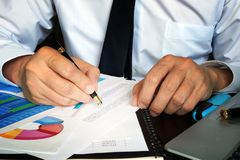 Financial report. Businessman working in an office with documents. Financial report stock image