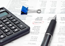 Financial report with calculator and pen. Financial report as background for calculator and pen royalty free stock images