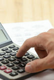 Financial report with calculator Royalty Free Stock Image