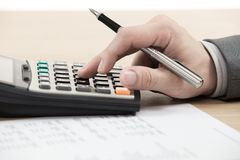 Financial report with calculator. On table Royalty Free Stock Images