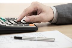 Financial report with calculator Stock Image