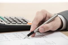 Financial report with calculator Stock Images
