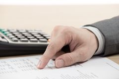 Financial report with calculator royalty free stock photos