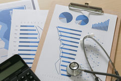 Financial report chart and calculator Medical Report and stetho Stock Image