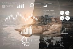 Double exposure of success businessman using digital tablet with. Financial report data of business operations (balance sheet and income statement and diagram) Stock Photos