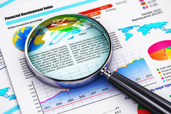 Financial report documents and magnifying glass Stock Image