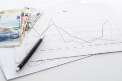 Financial report with Euro money on a table Royalty Free Stock Image