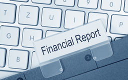 Financial Report - folder with text on computer keyboard. In the office stock images