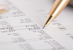 Financial report. Number in financial report underlined by blue pen royalty free stock images
