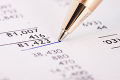 Financial report. Number in financial report underlined by blue pen Stock Photo