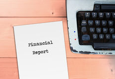 Financial report on paper and typewriter. Money and business concept Royalty Free Stock Photos