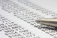 Financial report and pen. Financial data with a pen. Close up Royalty Free Stock Photo