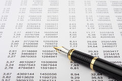 Financial report and pen. Table of the financial report and black fountain pen Royalty Free Stock Image