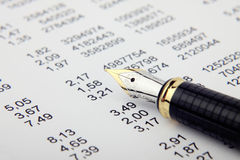 Financial report and pen. Table of the financial report and black fountain pen Royalty Free Stock Images