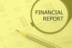 Financial report words. Magnifying glass and pencil on a numbers background. Financial report words. Magnifying glass and pencil on a calculation background Royalty Free Stock Photography