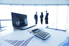 Financial reports. Calculator and laptop on table in office Royalty Free Stock Photography