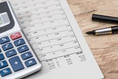 financial reports with calculator, pen. royalty free stock photo