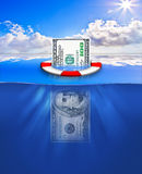 Financial Rescue. A money bill floating in the see being rescued by a lifebelt Royalty Free Stock Image