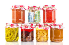 Financial reserves money conserved in a glass jar. Among others preserves Stock Image