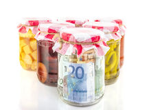 Financial reserves money conserved in a glass jar Stock Images