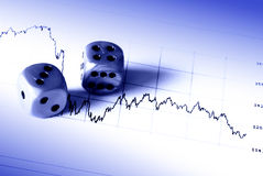Financial risk. Dices on a stock market document - Financial risk concept - blue tone