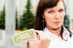 Financial risk. Dollar flutters in the hands of women Royalty Free Stock Photography