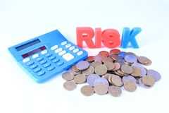 Financial Risk. Calculator with Risk word and pile of coins  isolated on white background Stock Photos
