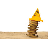 Financial risk. Coins falling and Warning label on whitebackgrou Stock Image