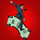 Financial Rodeo businessman riding a dollar. Pop art retro style. Business concept the rich man and success Royalty Free Stock Photography