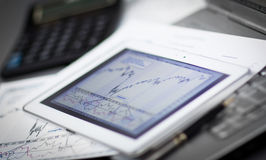 Financial schedule on the tablet screen Stock Image