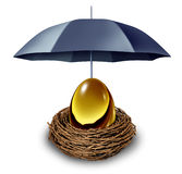Financial Security. And retirement fund insurance symbol with a golden egg in a nest protected by a black umbrella against down turns in the economy and as a Stock Photography