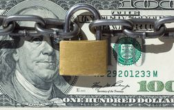 Financial security concept image. One hundred dollars locked  with padlock Stock Photo