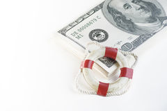 Financial security concept image.  Life buoy and cash Royalty Free Stock Images