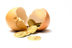 Financial security - Cracked egg with coins. Cracked egg with coins depicting savings Royalty Free Stock Photo