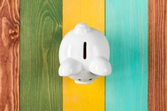 Financial security or personal funds concept. White piggy bank on color wooden background, top view Stock Photos