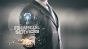 Financial Services with bulb hologram businessman concept stock video footage