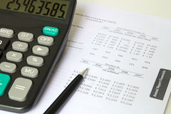 Financial sheet. Annual financial report with calculator and pen Stock Images