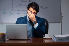 The financial specialist working late in the office. Financial specialist working late in the office royalty free stock images