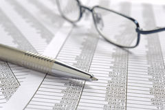 Financial spread sheet. With pen and glasses Royalty Free Stock Images